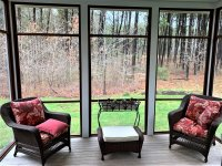 Porch has wooded views and